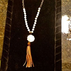 Beaded leather tassel necklace with white flower